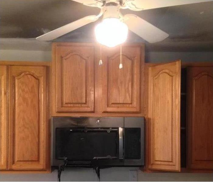 Same cabinets after they were cleaned and didn't need to be replaced