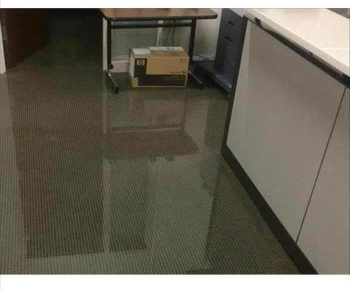 Office floor showing inches of water flooding